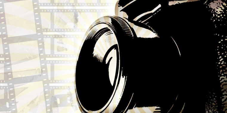retro-slr-camera-background-with-film-strips